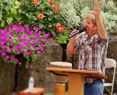 Pastor Rob Verdeyen teaching in the outdoor amphitheater at Calvary Chapel Corvallis
